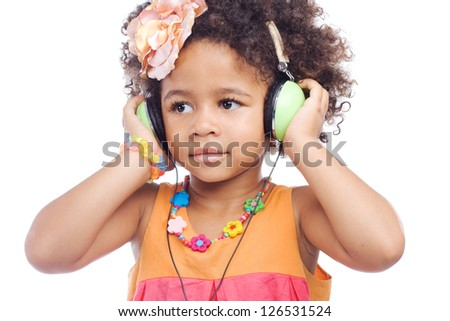 Cute little girl in big headphones against white background - stock photo