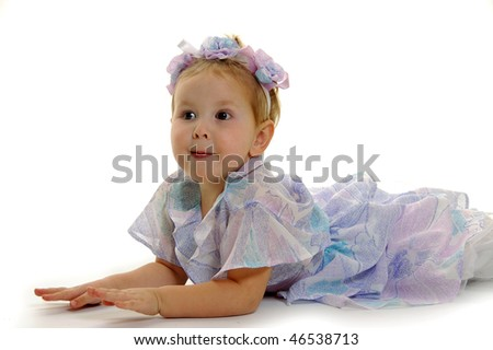 Cute little girl in blue dress isolated on white