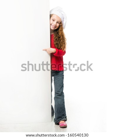 Cute little girl in chef hat with a white board - stock photo