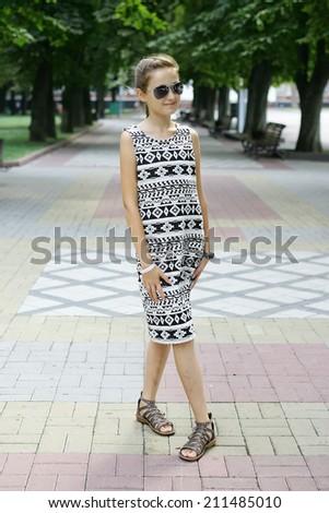 Cute little girl in  dress  - stock photo
