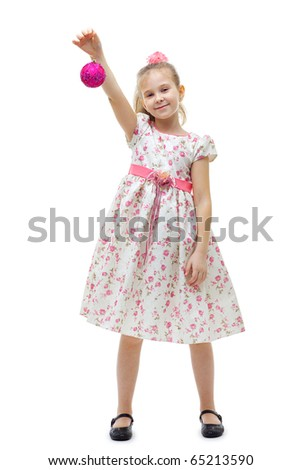 Cute little girl in dress playing with a christmas-tree decoration on white background isolated