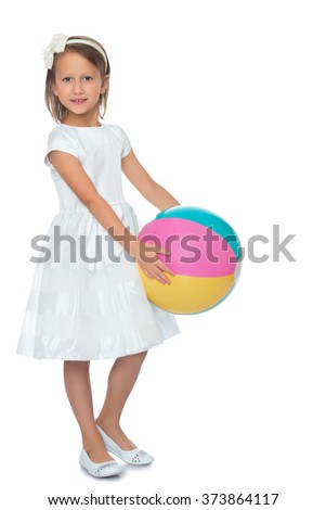 Cute little girl in fancy white dress holding a big striped beach ball - Isolated on white background