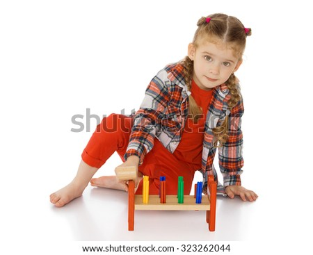 Cute little girl in Montessori kindergarten work-Isolated on white background - stock photo