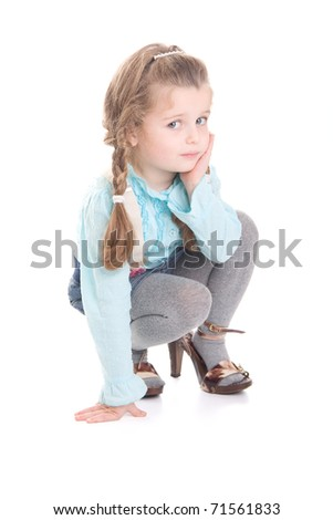 Cute little Girl  In Mummy 's shoes isolated on white background - stock photo