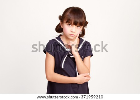 cute little girl in navy blue outfit,portrait, isolated on white background - stock photo