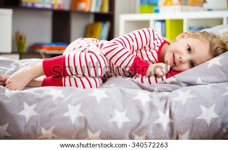 Cute little girl in pajama sleeping in bed