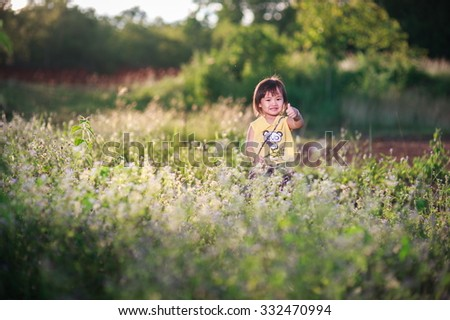 Cute little girl in playing in a heath park