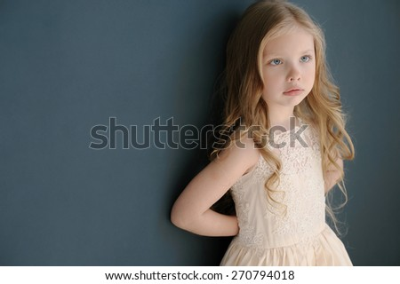 Cute little girl in princess lace dress - stock photo