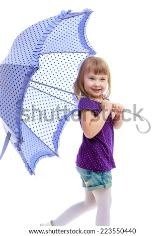 Cute little girl in summer clothes holding umbrella.Happy childhood, fashion, autumnal mood concept. Isolated on white background
