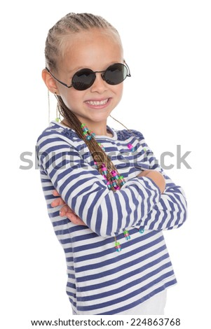Cute little girl in sunglasses isolated on white background. Girl is six years old.  - stock photo