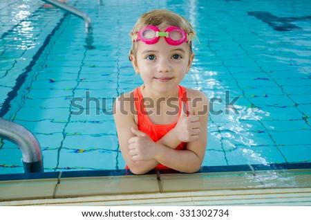 Cute little girl in swimming pool - stock photo