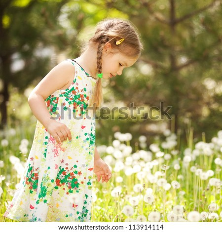 Cute little girl in the park - stock photo