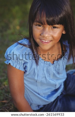 Cute little girl in the park on a sunny day