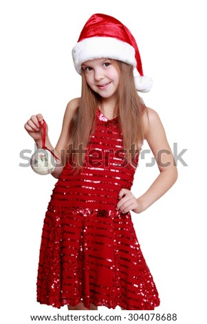 Cute little girl in the santa claus hat on holiday theme/Cheerful happy caucasian little santa girl on Christmas - stock photo