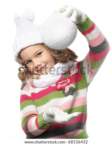 cute little girl in warm clothes with snowball on white background - stock photo