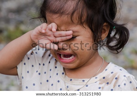 Cute little girl is crying - stock photo