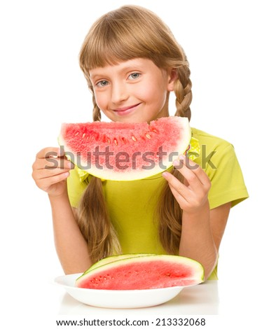 Cute little girl is eating watermelon, isolated over white - stock photo