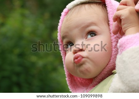 Cute little girl is frowning, face - stock photo