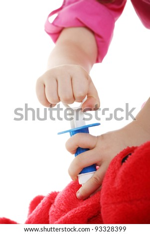 Cute little girl is playing doctor - stock photo