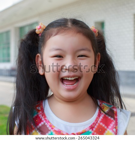 Cute little girl laughing outdoor - stock photo