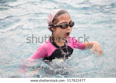 Cute little girl learning to swim