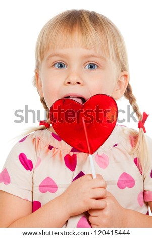 Cute little girl licking big red heart shaped lolly pop candy - stock photo
