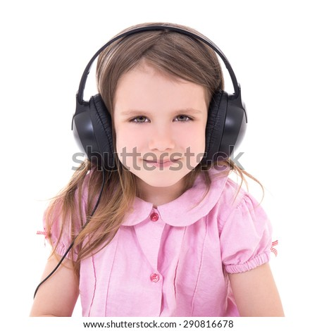 cute little girl listening music in earphones isolated on white background - stock photo