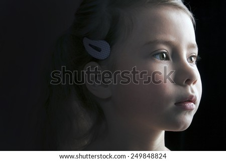 Cute little girl looking away - stock photo
