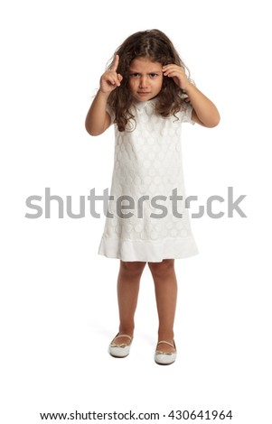 Cute little girl making an angry expression pointing finger - stock photo