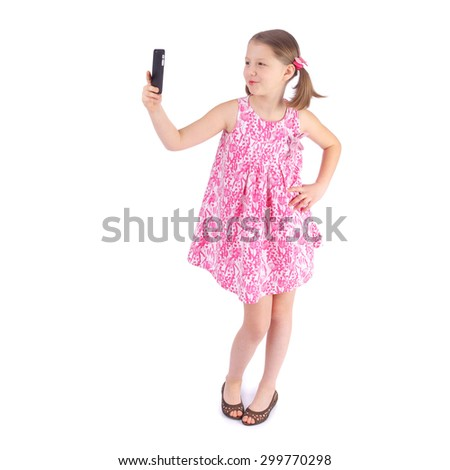 cute little girl making selfie - stock photo