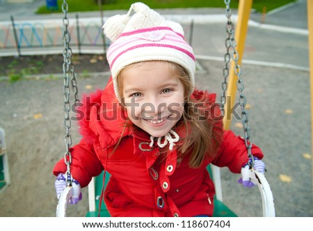 Cute little girl on a playground equipment - stock photo
