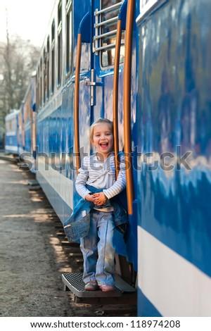 Cute little girl on a train - stock photo