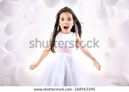 Cute little girl on balloon background - stock photo