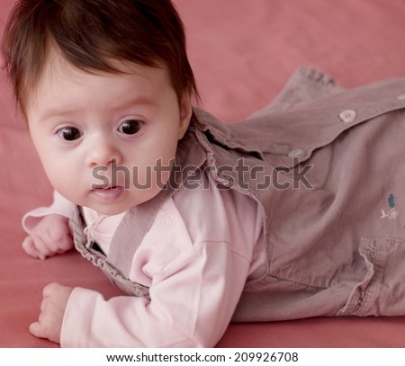 Cute little girl on pink background