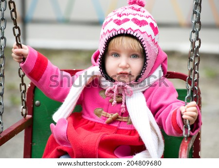 Cute Little girl on the playground - stock photo