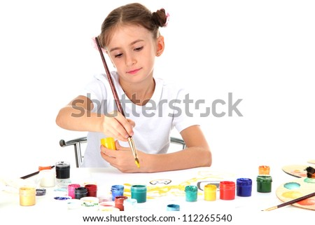 Cute little girl painting a picture, isolated on white - stock photo