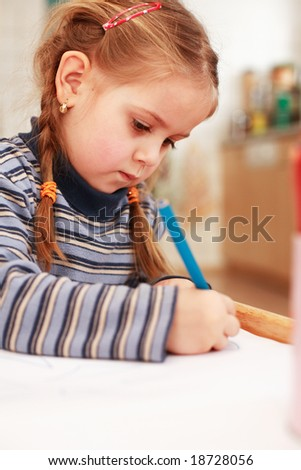 Cute little girl painting at home - stock photo