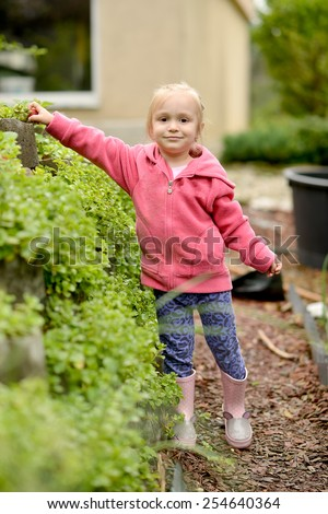 Cute little girl picking strawberries  - stock photo