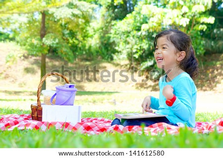 Cute little girl picnic at the playground