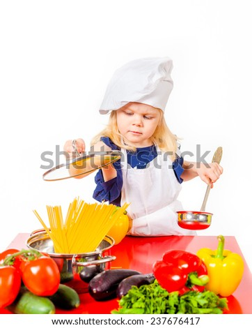 Cute little girl plaing in cook on white background