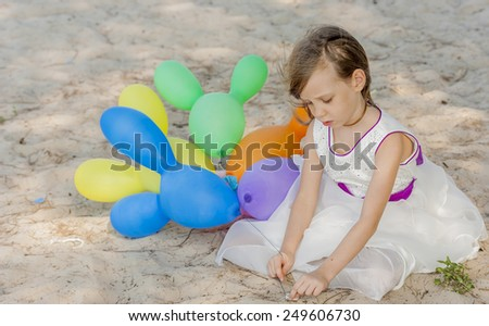 Cute little girl playing at the beach - stock photo