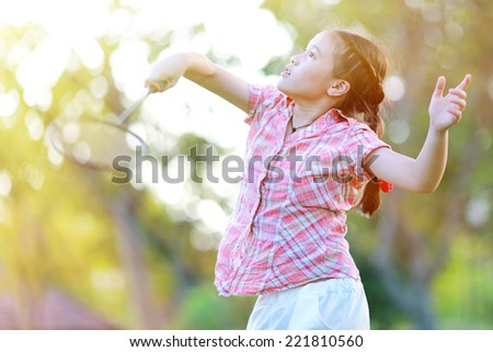 Cute little girl playing badminton - stock photo
