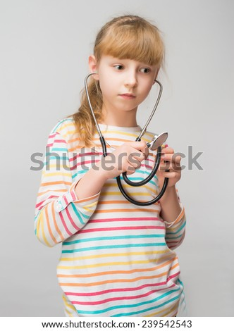 cute little girl playing doctor