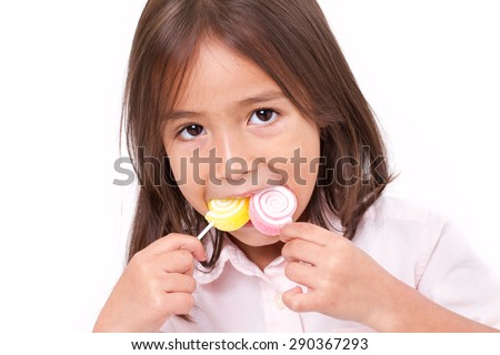cute little girl playing, eating sugar jelly sweet candy