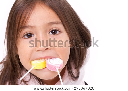 cute little girl playing, eating sugar jelly sweet candy - stock photo