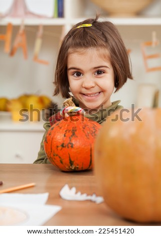 Cute little girl playing having fun for Halloween - stock photo