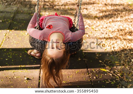 Cute little girl playing in the park on a nice warm day - stock photo