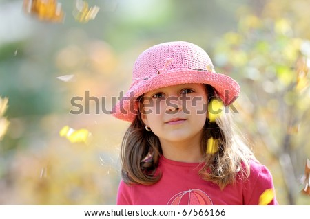 cute little girl playing outdoor in autumn - stock photo