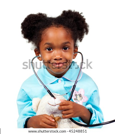 Cute little girl playing with a stethoscope against a white background - stock photo