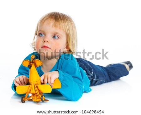Cute little girl playing with a toy airplane. Isolated on white background